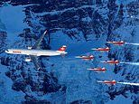 Airbus A321 and F-5E Tiger fighter jets weave between mountains ahead of Alpine Ski World Cup