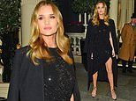 Rosie Huntington-Whiteley exudes glamour in black shimmering gown
