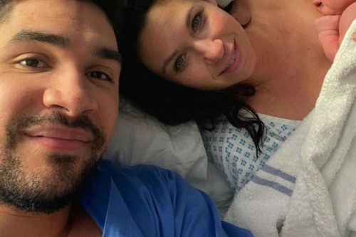Louis Smith is a doting dad as he cuddles three-week-old daughter Marley