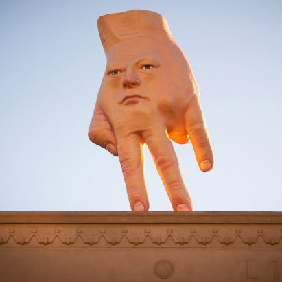 """""""Giant hybrid face-hand"""" installed on roof of art gallery in Wellington"""