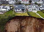 Dramatic moment tons of mud and rock fell onto North Wales beach in 130ft wide landslide