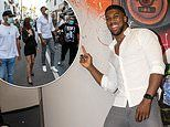 Anthony Joshua is a hit with the locals as he signs a mural of himself in a Marbella sports shop