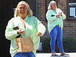Gemma Collins flashes a smile while stocking up on seafood supplies inEssex