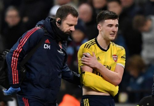 Kieran Tierney leaves field with arm in make-shift sling as Arsenal lose TWO full-backs in one night