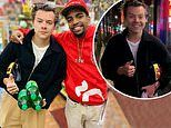 Harry Styles is surprised by a street performer in LA who performs amazing trick for him