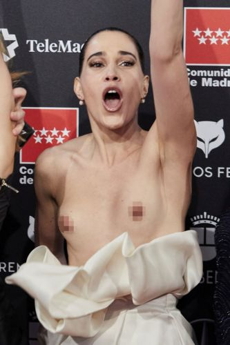 Is this history's worst wardrobe malfunction? Spanish actress's dress falls down to her waist as she celebrates win