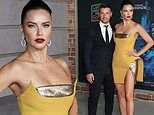 Adriana Lima shows model legs in mini dress with Andre Lemmers at Last Night In Soho premiere in LA