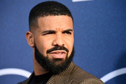 Drake is hanging out with Rihanna's brother while on holiday in Barbados