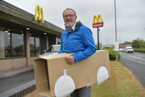 McDonald's customer in a cardboard box 'car' queues up at drive-thru as fast food chain re-opens