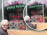 Heartwarming moment girl plays a game of tic-tac-toe with her grandmother on her glass window