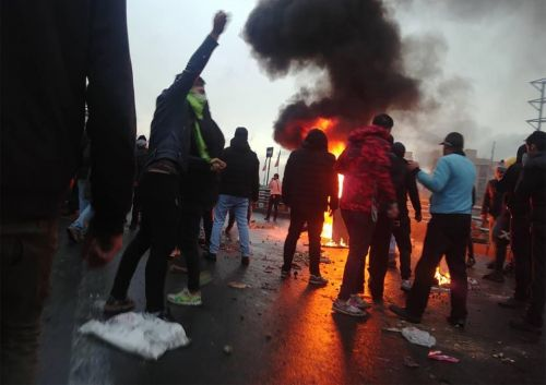 Iran protests leave '14 dead' as demonstrators burn buildings and clash with cops across country after fuel hike