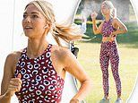 Sam Frost is sprayed with water by crew as she films Home and Away workout scenes