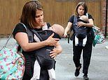 Nadia Essex is every inch the doting mum as she cradles son Ezekiel in his baby carrier