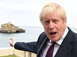 'You can't find a way through if you just sit on the beach!' Boris Johnson takes early-morning swim