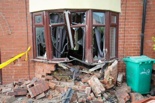 'Stolen' car smashes into house after 'police chase' as mum and son, 8, slept