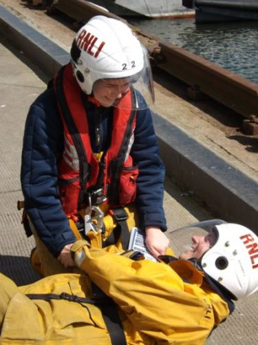 Boyfriend dresses up as crewman to shock lifeboat woman with proposal during training drill