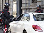 Couple caught having sex in a car in Milan are arrested for breaching coronavirus lockdown