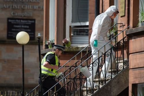 Body of man found at Glasgow flats as police forensics comb scene