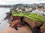 Warning after massive section of luxury flats' garden collapses into the sea in Torquay