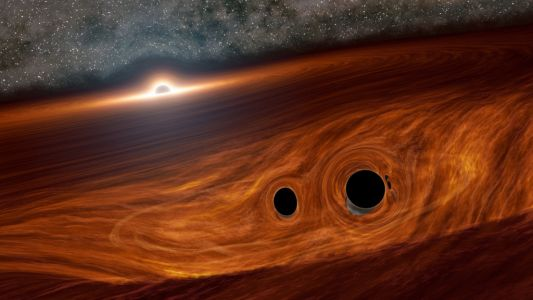 Physicists observe flare with the light of a trillion suns as black holes merge in distant galaxy