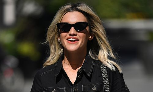Ashley Roberts teams her high-street denim dress with a pair of colourful dad trainers