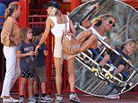 Elsa Pataky shows off her pins in tiny shorts as she takes her children to Sydney's Luna Park