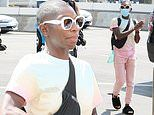 Michaela Coel goes casual in pink sweatpants as she jets out of LA after her Emmys win