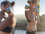 Heidi Klum flashes her toned stomach as she works up a sweat pumping weights at home