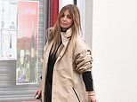 Louise Redknapp cuts a stylish figure in Balenciaga raincoat as she arrives to prepare meals
