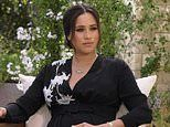 Pregnant Meghan Markle cradles her baby bump in trailer for Oprah interview
