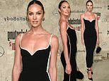 Candice Swanepoel exudes glamour in a figure-hugging little black dress during Berlin Fashion Week