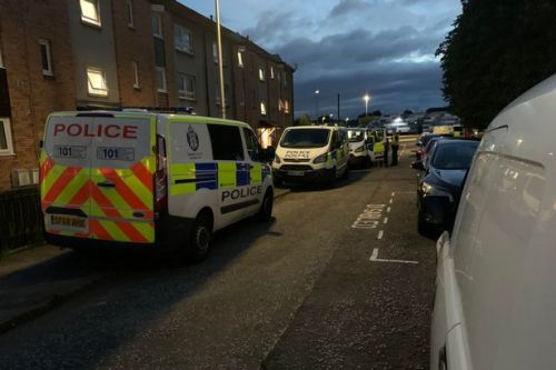 Police race to Grangemouth as officers seen running into flats