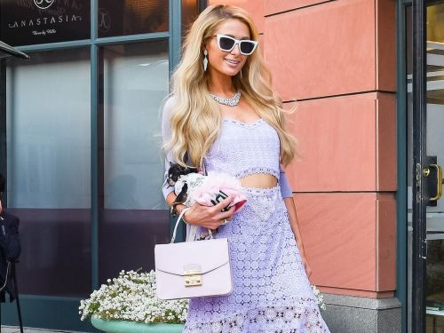Paris Hilton wore a purple knit dress to match her holographic BMW