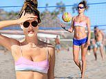 Alessandra Ambrosio models her enviable figure during a beach day where she lounges on the sand