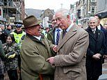 Prince Charles climbs into water-logged cellar to see devastation caused by Storm Dennis