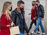 Antonio Banderas holds handswith his girlfriendNicole Kimpel while out for a stroll