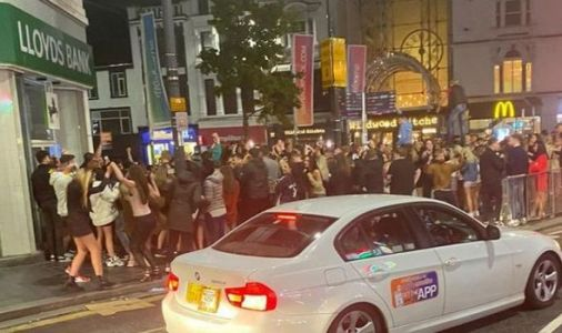 'Absolute disgrace!' Fury as huge crowds party on streets after 10pm curfew