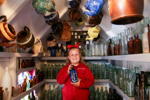 Girl, 7, opens antique bottle business in back garden and make hundreds from things she's salvaged
