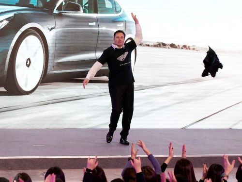 Tesla is reporting earnings this week - here's why analysts predict the automaker will close in on its first-ever annual profit
