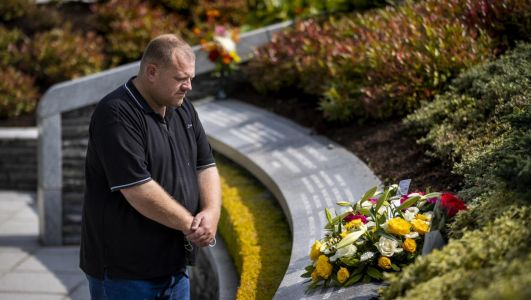 Relatives of Omagh bomb victims lay floral tributes to mark darkest day