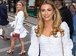 Dani Dyer makes a stylish arrival to beauty bash in a flirty white mini dress and studded heels