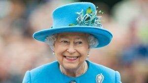 Here's why The Queen wore bright lipstick to address the nation on Sunday