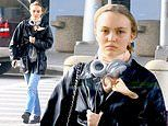Lily-Rose Depp rocks chic airport ensemble as she jets into New York from her hometown in Paris