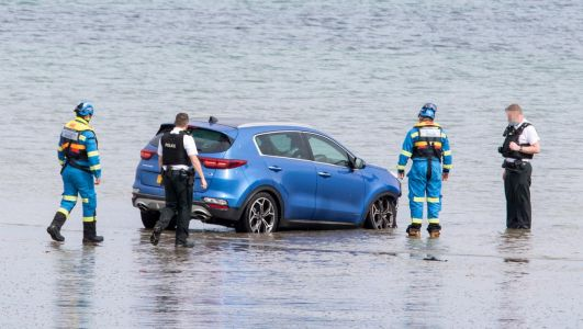Female driver taken to hospital after car enters water in Millisle
