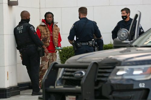 Cardi B's husband Offset films as he's pulled from his car and detained by police near Trump rally