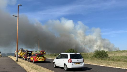 Belfast residents told to close windows as firefighters tackle large gorse fire in Duncrue area