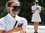 Natalie Portman looks angelic in an all-white ensemble complete with terrifying mask