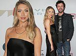 Stassi Schroeder keeps in simple in classic black for Grammy's charity event with fiance Beau Clark