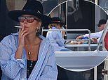 Pip Edwards smokes a cigarette as she enjoys a romantic yacht cruise with boyfriend Michael Clarke