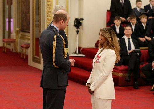 M.I.A. is proud as punch to receive MBE from Prince William after revealing her mum hand stitches the Queen's medals